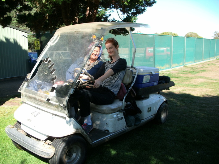 Lilian driving a golf cart at the Heat Pumps NOW Christchurch fundraiser.